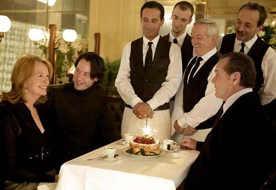 """Cast members of Columbia Pictures' romantic comedy """"Something's Gotta Give,"""" Diane Keaton, far left, Keanu Reeves, second from left, and Jack Nicholson, right, are shown in a scene from the film in this undated promotional photo. While Keaton first heard of the role she figured no studio would back a romance that was not about sweet young 20- or 30-somethings. (AP Photo/Columbia Pictures, Bob Marshak) Photo: BOB MARSHAK"""