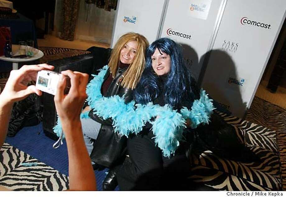 """rockstar180023_mk.jpg Dressed as rock stars, Paula Camarena and Julie Vaiz of San Jose pose for the camera during the Shop Like a Rock Star benefit at Saks.  Folk from around the Bay Area come to """"Shop Like a Rockstar"""" at a benefit for Save the Music Foundation at Saks in San Franicso's Union Square. 12/18/03 in San Francisco MIKE KEPKA/The Chronicle Photo: MIKE KEPKA"""