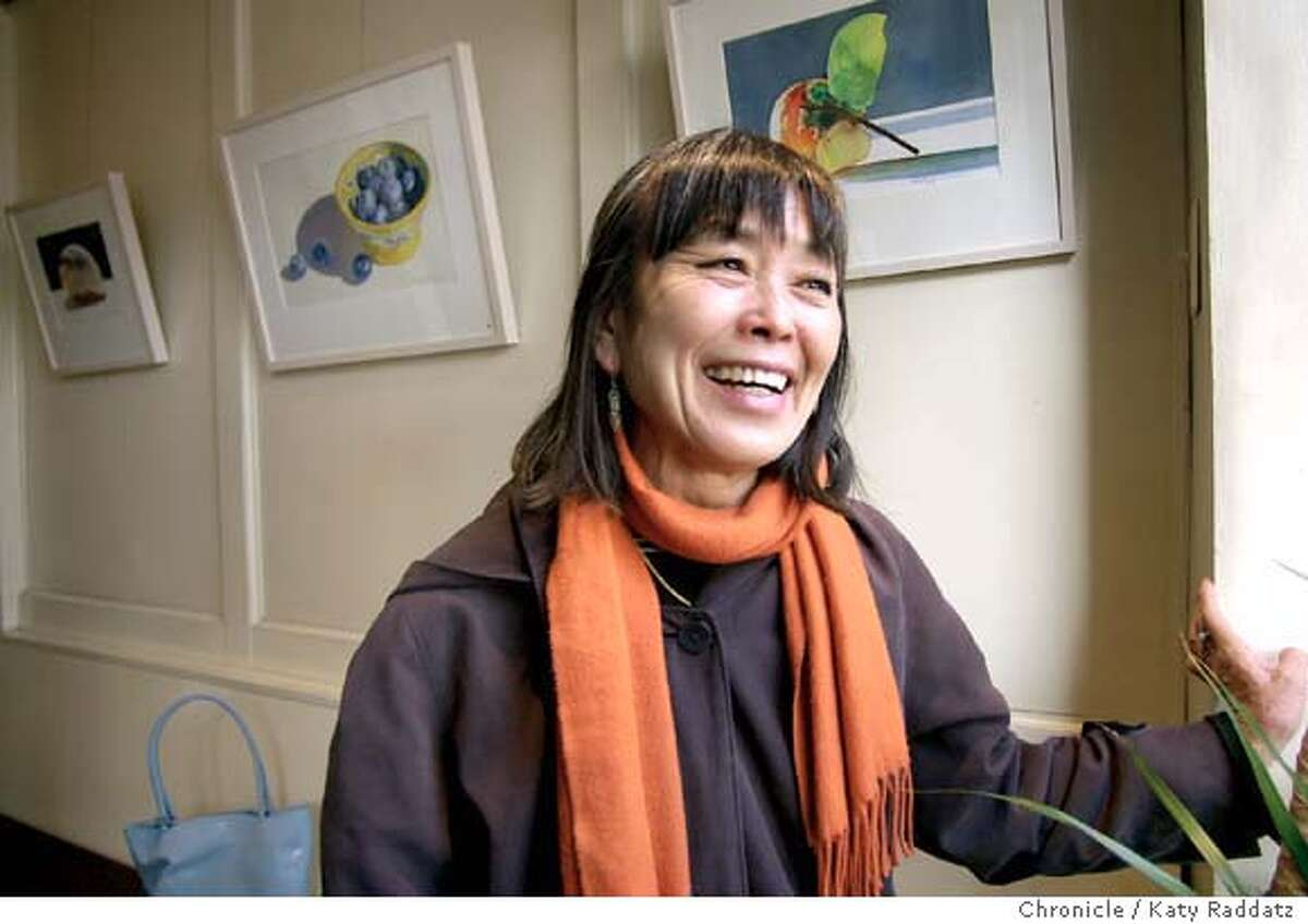 Wendy Yoshimura, a participant in the Symbionese Liberation Army bank robbery, and connected to Patty Hearst, has a watercolor show in Cafe 817, an Oakland cafe at 817 Washington St. Wendy's smiling at a friend walking by on the sidewalk outside the cafe. KATY RADDATZ / The Chronicle