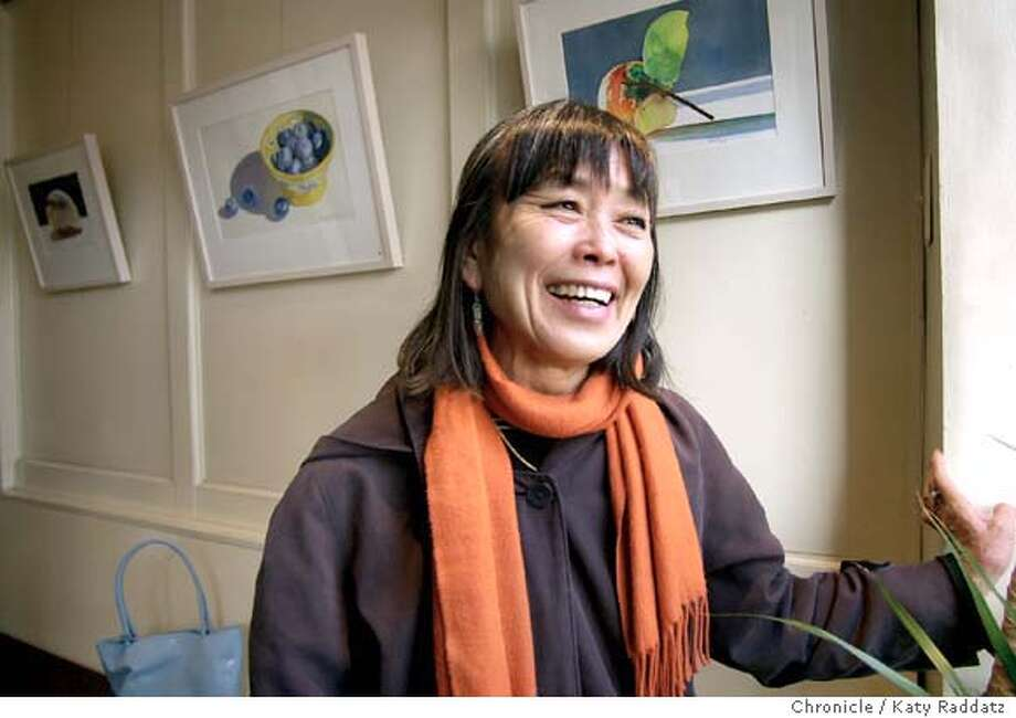 Wendy Yoshimura, a participant in the Symbionese Liberation Army bank robbery, and connected to Patty Hearst, has a watercolor show in Cafe 817, an Oakland cafe at 817 Washington St. Wendy's smiling at a friend walking by on the sidewalk outside the cafe. KATY RADDATZ / The Chronicle Photo: KATY RADDATZ