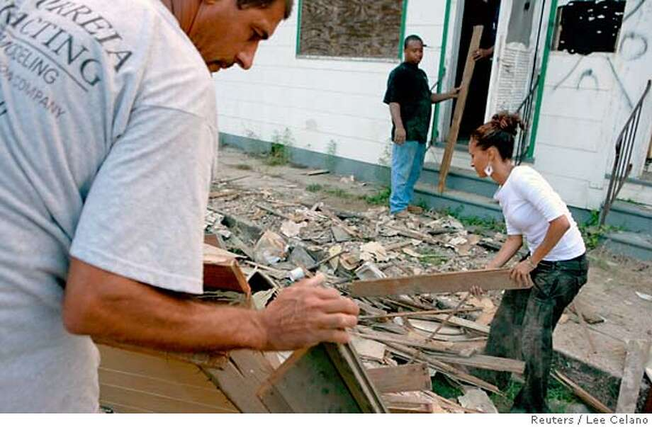 Residents sort through lumber from a flood-damaged house in the Lower Ninth Ward of New Orleans, Louisiana, August 18, 2007. Hurricane Katrina devastated the Gulf Coast, including New Orleans, in August 2005. REUTERS/Lee Celano (UNITED STATES) 0 Photo: LEE CELANO