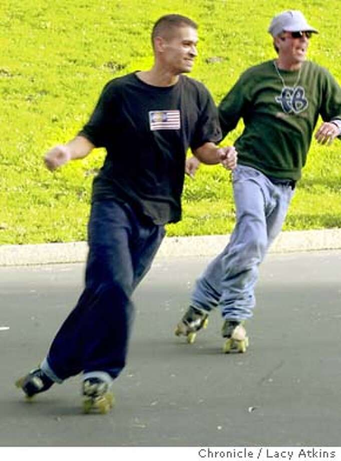 Eddy Uribe and Terry Smith skate in rhythem at Golden Gate Park, Sunday Dec.21, 2003, in San Francisco. Old-fashioned roller skates are making a big comeback, at least in the Bay Area, according to skating instructors and industry insiders because they make it easier to dance on wheels. Spokespeople for USA Rollersports and the National Museum of Roller Skating say the re-emergence of roller discos and recreational quad skating is due mainly to nostalgia.  Lacy Atkins / The Chronicle Photo: Lacy Atkins