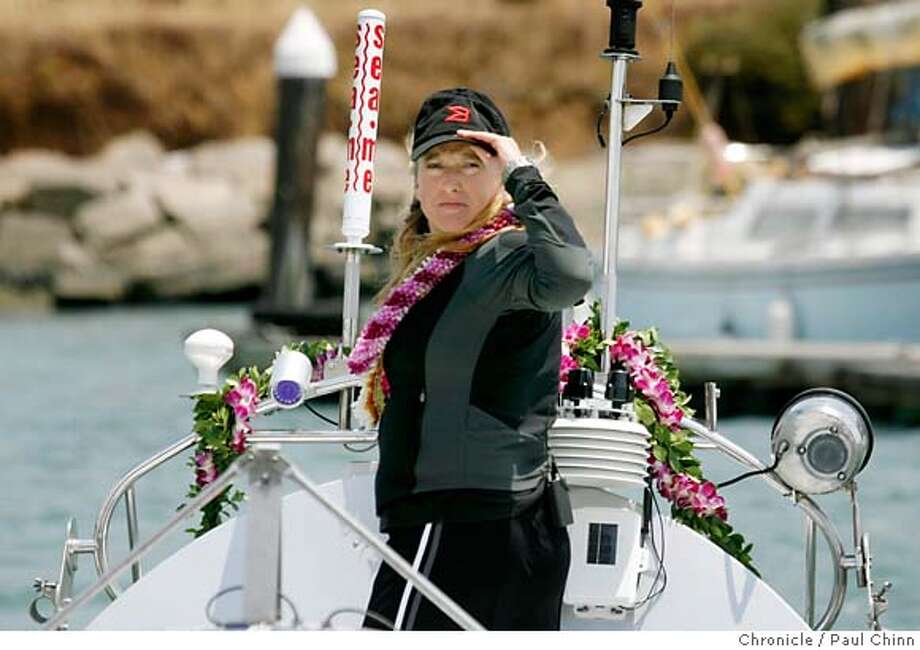 Roz Savage is towed out to the Golden Gate to prepare for her rowing adventure on the Pacific Ocean after a news conference at Fort Baker in Sausalito, Calif. on Tuesday, July 10, 2007. Savage, who successfully rowed her vessel solo across the Atlantic Ocean in 2006, hopes to embark on the first leg of her solo journey, a three-month trek to Hawaii, sometime Thursday night.  PAUL CHINN/The Chronicle  **Roz Savage  Ran on: 07-11-2007  Roz Savage, 39, on the deck of her 24-foot rowboat Brocade, leaves from San Francisco later this week on her transpacific journey.  Ran on: 07-11-2007  Roz Savage, 39, on the deck of her 24-foot rowboat Brocade, leaves from San Francisco later this week on her transpacific journey. MANDATORY CREDIT FOR PHOTOGRAPHER AND S.F. CHRONICLE/NO SALES - MAGS OUT Photo: PAUL CHINN