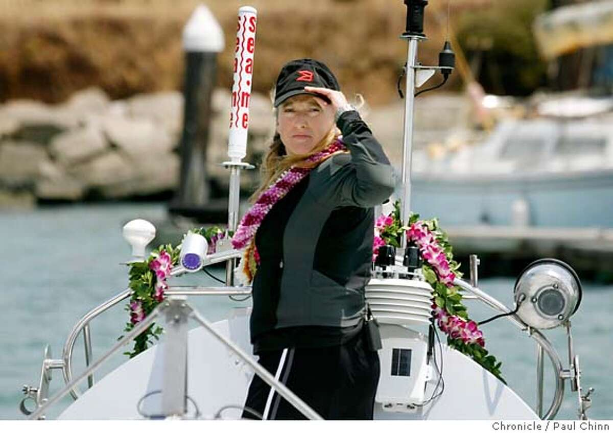 Roz Savage is towed out to the Golden Gate to prepare for her rowing adventure on the Pacific Ocean after a news conference at Fort Baker in Sausalito, Calif. on Tuesday, July 10, 2007. Savage, who successfully rowed her vessel solo across the Atlantic Ocean in 2006, hopes to embark on the first leg of her solo journey, a three-month trek to Hawaii, sometime Thursday night. PAUL CHINN/The Chronicle **Roz Savage Ran on: 07-11-2007 Roz Savage, 39, on the deck of her 24-foot rowboat Brocade, leaves from San Francisco later this week on her transpacific journey. Ran on: 07-11-2007 Roz Savage, 39, on the deck of her 24-foot rowboat Brocade, leaves from San Francisco later this week on her transpacific journey. MANDATORY CREDIT FOR PHOTOGRAPHER AND S.F. CHRONICLE/NO SALES - MAGS OUT