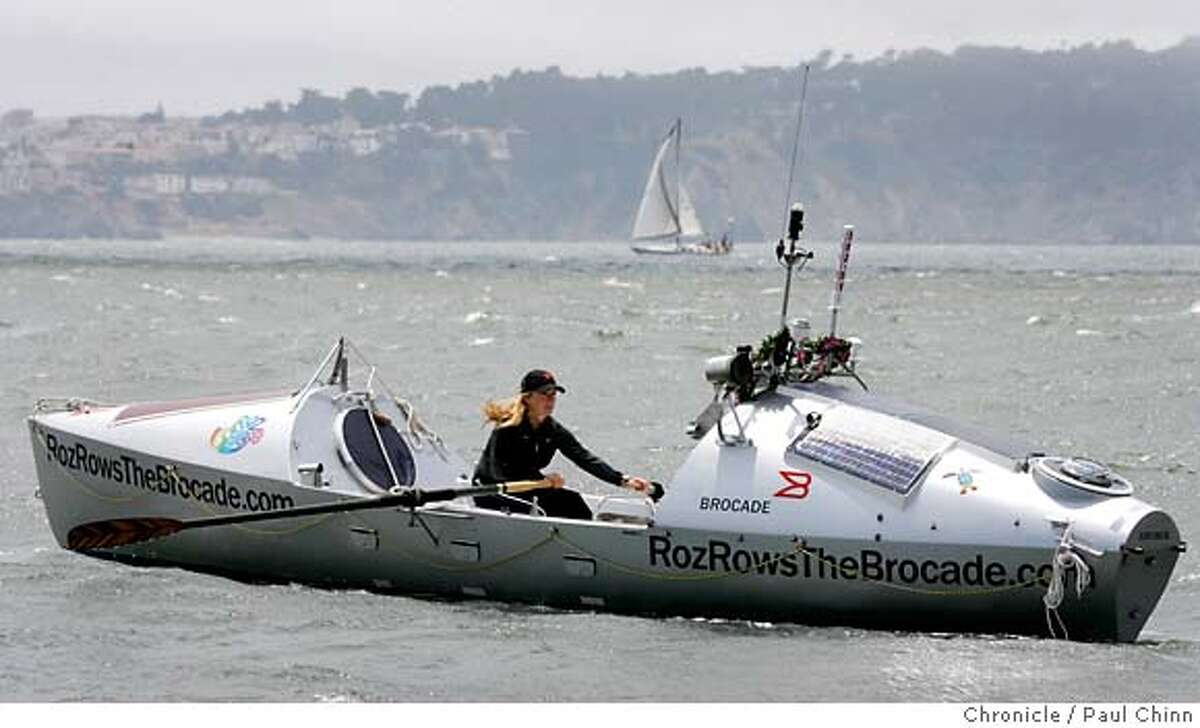 Roz Savage rows her high-tech boat near the Golden Gate Bridge while preparing for a rowing adventure on the Pacific Ocean in Sausalito, Calif. on Tuesday, July 10, 2007. Savage, who successfully rowed her vessel solo across the Atlantic Ocean in 2006, hopes to embark on the first leg of her solo journey, a three-month trek to Hawaii, sometime Thursday night. PAUL CHINN/The Chronicle **Roz Savage MANDATORY CREDIT FOR PHOTOGRAPHER AND S.F. CHRONICLE/NO SALES - MAGS OUT