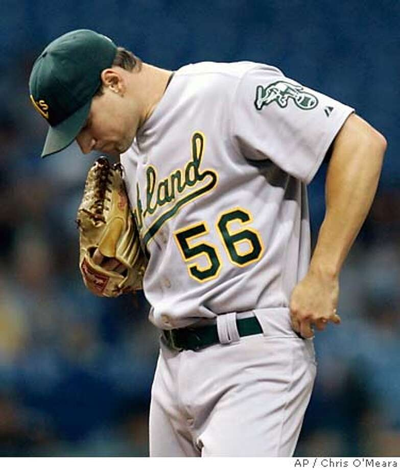 Oakland Athletics pitcher Lenny DiNardo reacts as manager Bob Geren makes his way to the mound during the third inning of a baseball game against the Tampa Bay Devil Rays on Friday night, Aug. 24, 2007, in St. Petersburg, Fla. DiNardo pitched two-plus innings, giving up six runs. (AP Photo/Chris O'Meara) Photo: Chris O'Meara