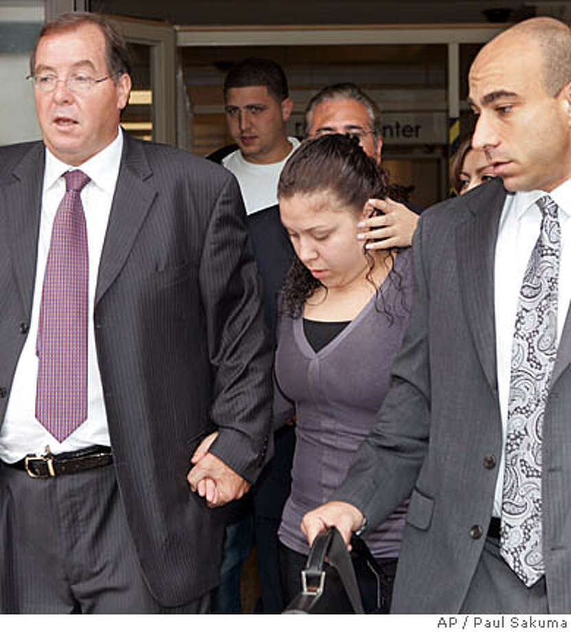 Edith Delgado, center, is led away from a Redwood City, Calif., courtroom by her attorney Randy Moore, left, and unidentified man, right, Friday, Aug. 24, 2007, after she received a two-year sentence for a freeway crash that killed two members of Tonga's royal family. Delgado was sentenced after being convicted earlier this year on misdemeanor manslaughter for a crash on Highway 101 that killed Prince Tu'ipelehake and Princess Kaimana. Their driver was also killed. (AP Photo/Paul Sakuma) Photo: Paul Sakuma