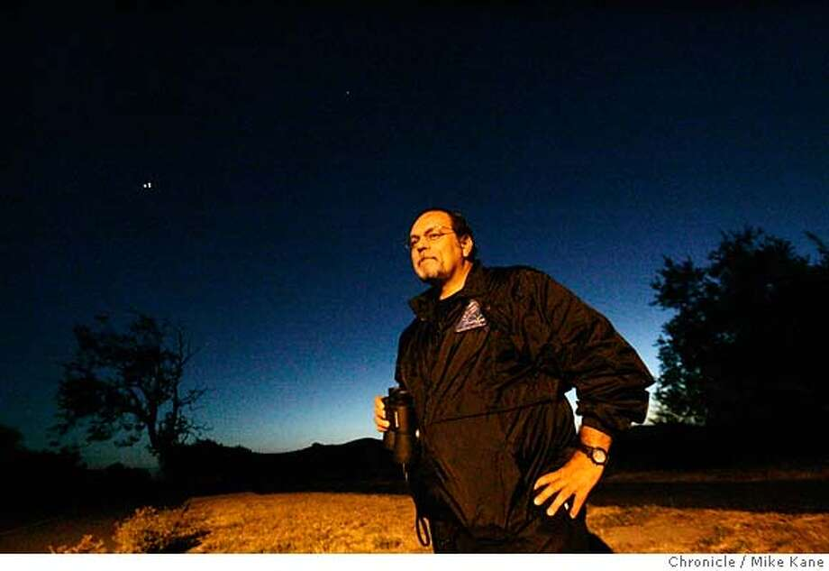 UFO_092_MBK.JPG  Robert Uriarte, state director of the Mutual UFO Network, at Coyote Hills Regional Park in Union City, CA, on Wednesday, August, 22, 2007. photo taken: 8/22/07  Mike Kane / The Chronicle *Robert Uriarte MANDATORY CREDIT FOR PHOTOG AND SF CHRONICLE/NO SALES-MAGS OUT Photo: Kane, Mike