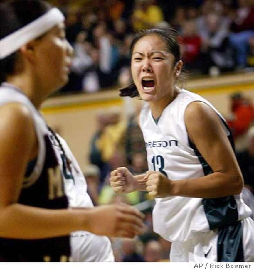Oregon's Corrie Mizusawa reacts after hitting the game-winning shot during the final seconds of the game with Montana on Friday, Dec. 12, 2003, at McArthur Court in Eugene, Ore. Oregon defeated Montana 53-52. (AP Photo/Rick Bowmer) Photo: RICK BOWMER