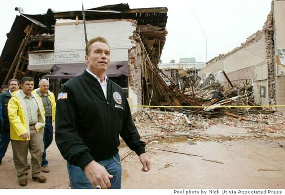 California Governor Arnold Schwarzenegger surveys the destruction in Paso Robles, approximately 180 miles north of Los Angeles, December 23, 2003. Rescue workers ended their search for survivors from a 6.5 magnitude earthquake that killed two women in this central California town and shook homes and skyscrapers from San Francisco to Los Angeles. Schwarzenegger declared a state of emergency in San Luis Obispo county. Nick Ut/POOL Photo: POOL