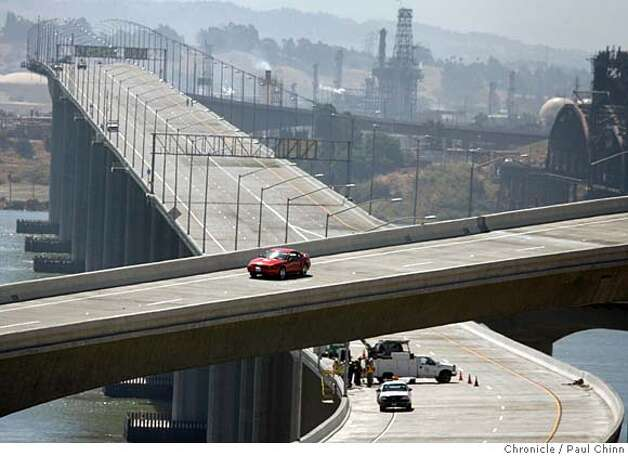 The new eastbound I-680 span (upper left) and toll plaza officially opens Saturday. Finishing touches were added to the brand new toll plaza for the Benicia-Martinez Bridge in Martinez, Calif. on Thursday, August 23, 2007. The facility features the Bay Area's first open-road tolling for FasTrak users approaching in the far left lanes.  PAUL CHINN/The Chronicle  Ran on: 08-24-2007  Bernard Paramore and Matt Thomas install a 5 mph speed limit sign at one of nine traditional toll lanes.  Ran on: 08-24-2007  Bernard Paramore and Matt Thomas install a 5 mph speed limit sign at one of nine traditional toll lanes. Photo: PAUL CHINN