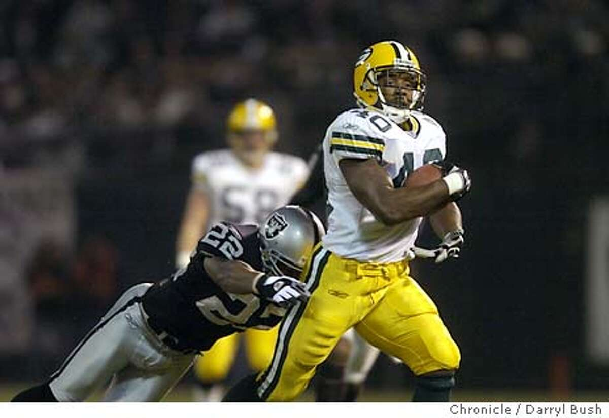 raiders23_002db.jpg Oakland Raiders Terrance Shaw cant stop Green Bay Tony Fisher after a long catch and run in the 1st qtr. vs. Green Bay Packers at Network Associates coliseum. 12/22/03 in Oakland. DARRYL BUSH / The Chronicle