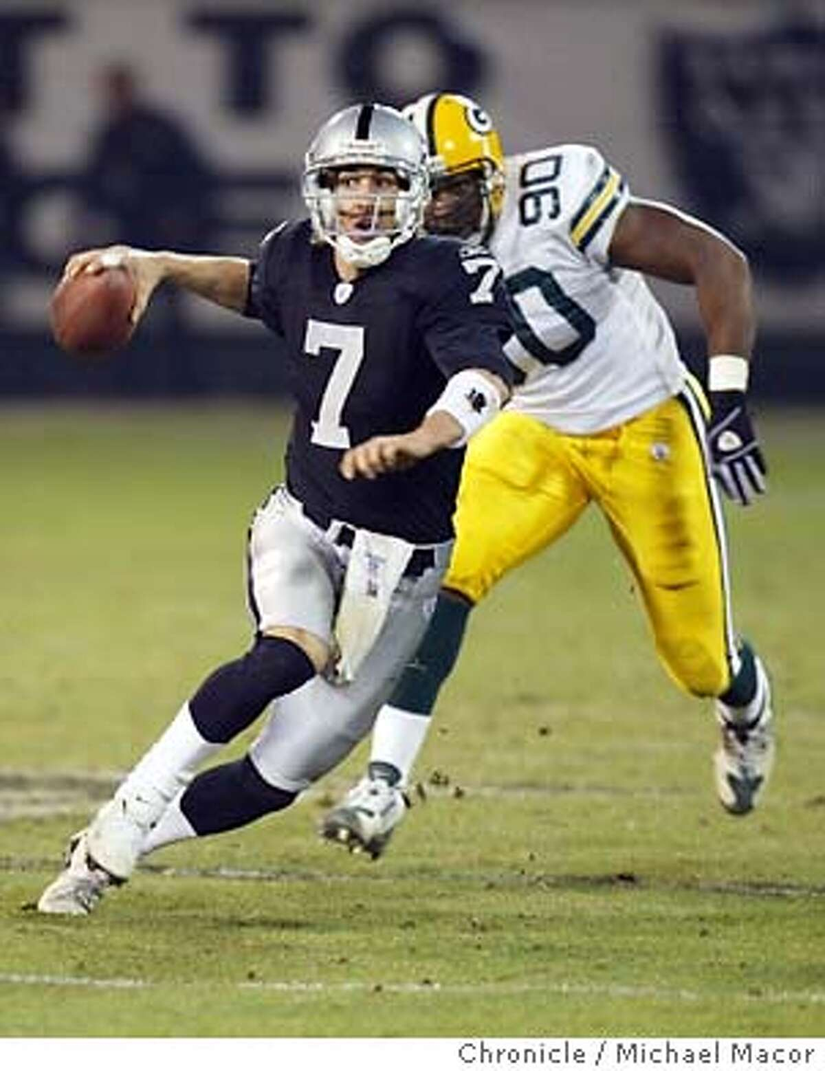 raiders214_mac.jpg Raiders7-Rob JOhnson came in to quarterback the 4th quarter, chased by 90-Chuckie Nwokorie. Monday NIght Footbal at the Oakland Coliseum. Oakland Raiders vs. Green Bay Packers Michael Macor/ The Chronicle