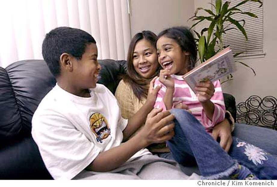 Chrystyne Rayrao (C), her son Devonte, 12, (L) and daughter Ernecia, 6, (R) live in an Alameda apartment, but work and go to school in San Francisco. Chrystyne's job earns her just enough to pay rent and expenses.  KIM KOMENICH/The Chronicle Photo: KIM KOMENICH