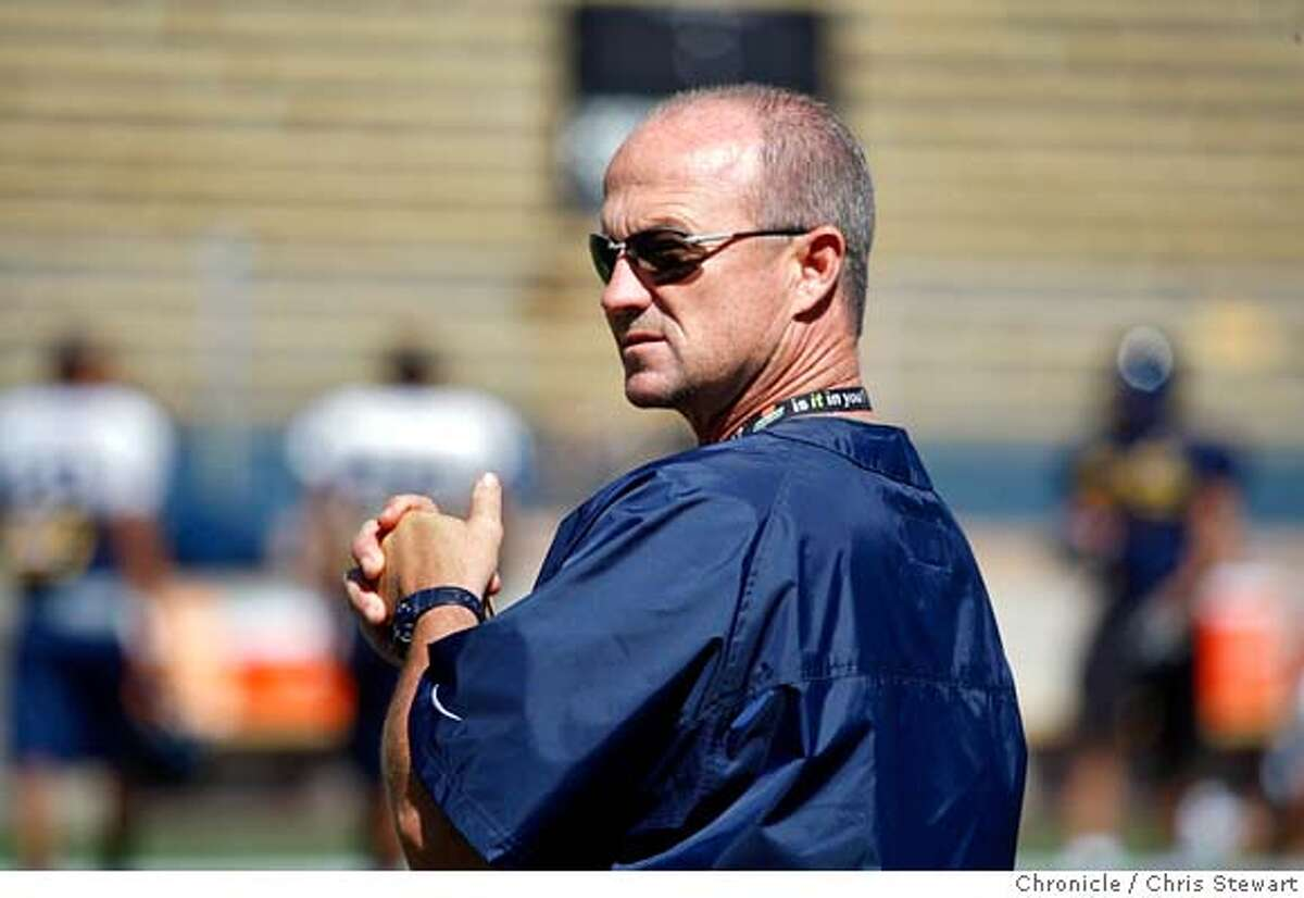 CAL_FOOTBALL_0026_cs.jpg Event on 8/9/07 in Berkeley Head coach Jeff Tedford (cq) watches a Cal Berkeley football team practice at Memorial Stadium. Photographed August 9, 2007 Chris Stewart / The Chronicle Cal Berkeley football, Jeff Tedford MANDATORY CREDIT FOR PHOTOG AND SF CHRONICLE/NO SALES-MAGS OUT