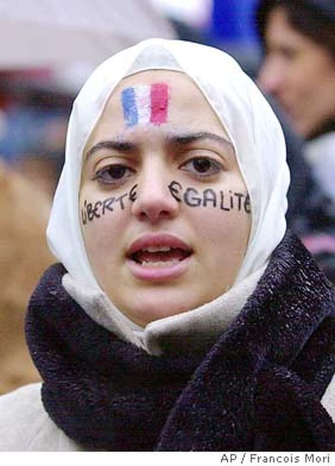 Muslims Protest Chiracs Plan To Ban Head Scarves Law Would Forbid