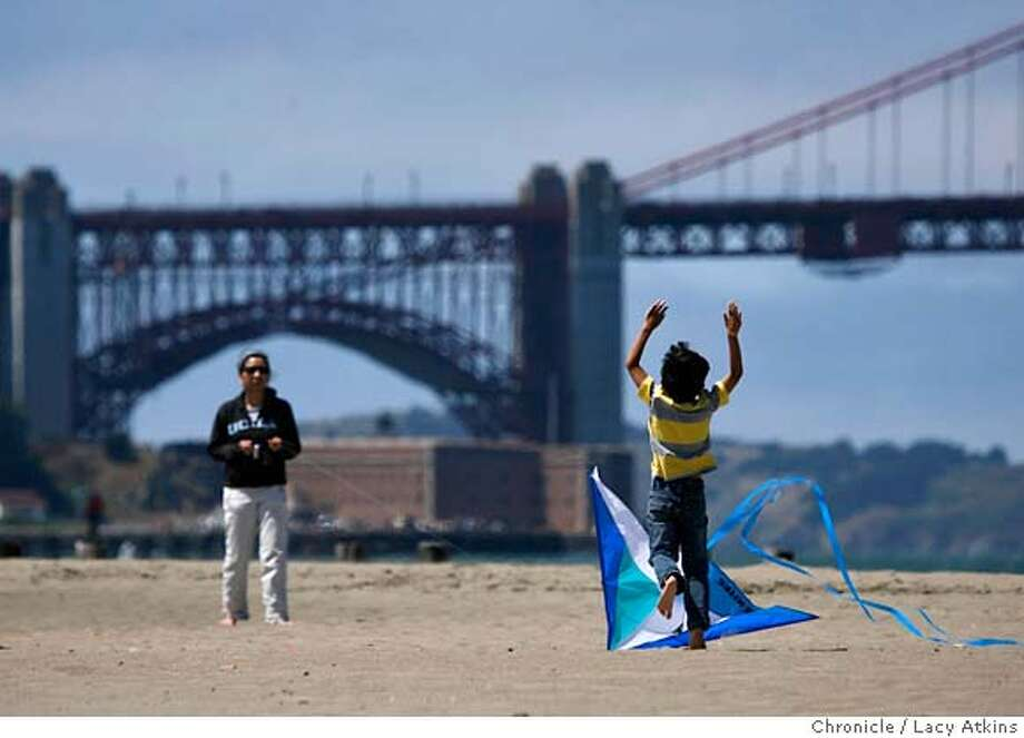 Sharon Pang flys a kite as her son Max Castro runs and plays at San Francisco's Crissy Field, Thursday Aug. 23, 2007, in San Francisco, Ca. The golden Gate National Recreation Area, Yosemite and Point Reyes will receive tens of millions of dollars to improve trails and boost education programs, according to an announcement made Thursday Aug. 23, 2007.(Lacy Atkins San Francisco Chronicle) MANDATORY CREDITFOR PHOTGRAPHER AND SAN FRANCISCO CHRONICLE/NO SALES-MAGS OUT Photo: Lacy Atkins