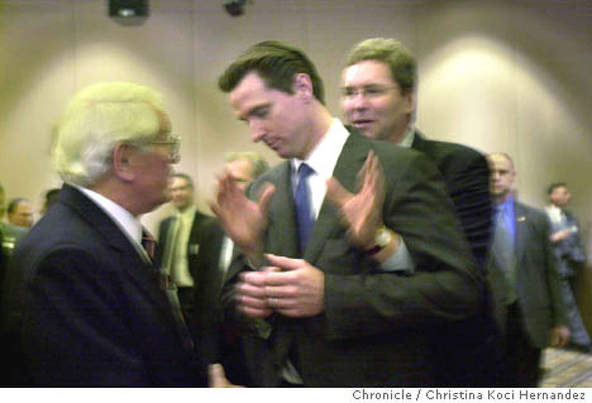 sfmayor_120403_kocihernandez Secretary of State, Kevin Shelley, sneaks up behind Newsom putting his hands under Newsom's arms. Mayoral candidate, Gavin Newsom, campaigns at the reception at the Union member Moose feed at the SF Hilton. CHRISTINA KOCI HERNANDEZ / The Chronicle