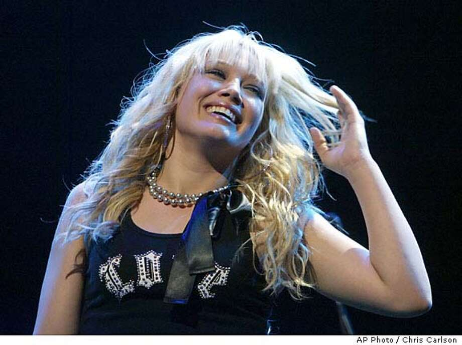Hilary Duff performs at KIIS-FMs Jingle Ball 2003 at the Staples Center in Los Angeles, on Friday, Dec. 5, 2003. (AP Photo/Chris Carlson) Photo: CHRIS CARLSON