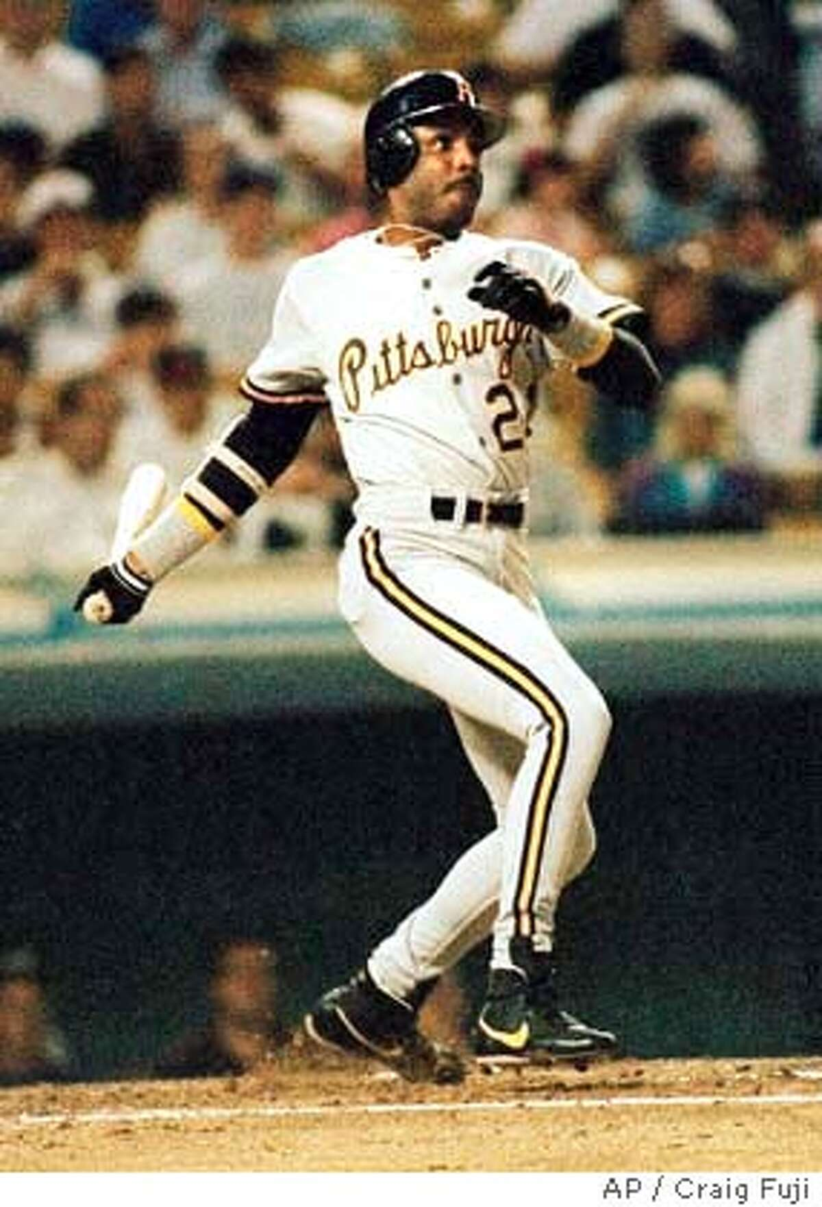 FILE--Pittsburgh Pirates' Barry Bonds hits against the Los Angeles Dodgers in this August. 25, 1992 file photo. Bonds is looking for affection, not money or trophies. He's likely to wind up with all three. ``I just want to be wanted,'' he said Monday, Nov. 19, 2001 after becoming the first player to win four Most Valuable Player Awards. (AP Photo/Craig Fuji)