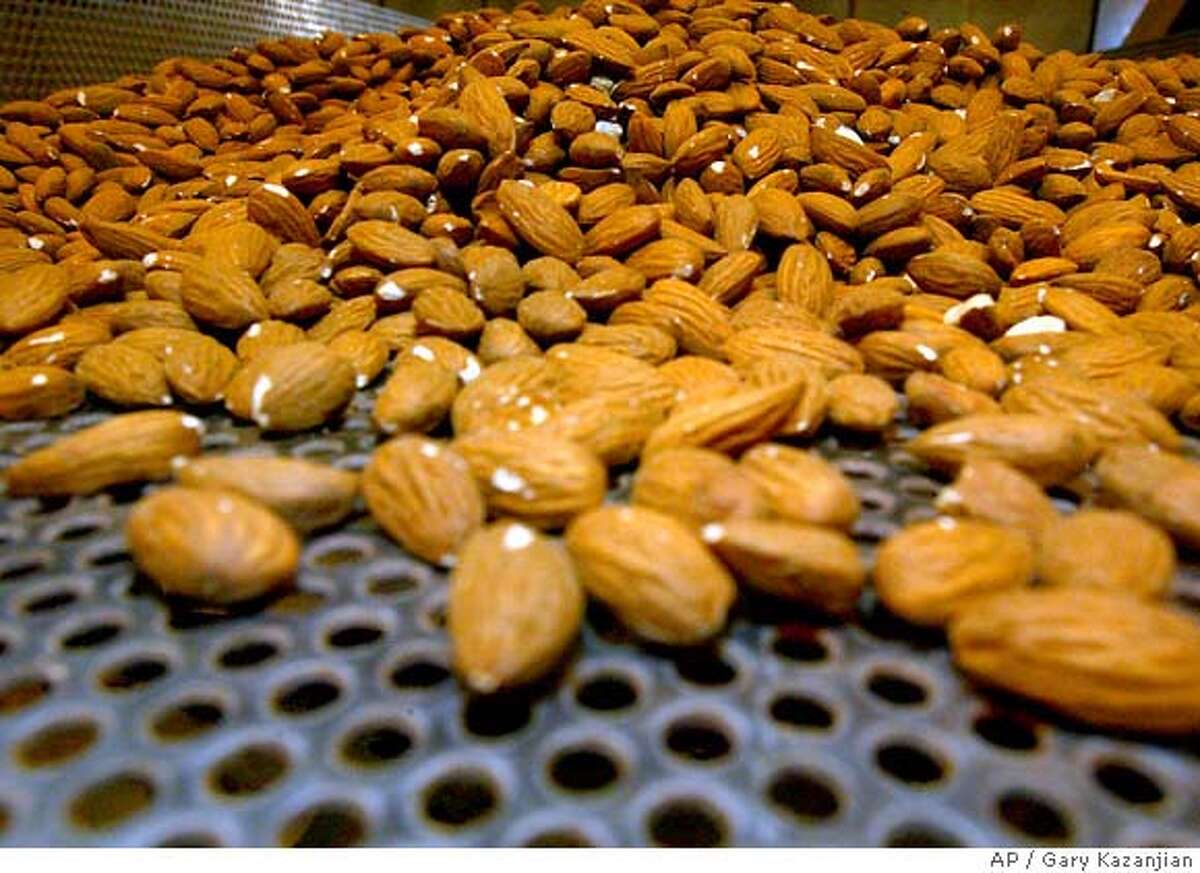 **FILE** Raw almonds are shown on a roasting tray in this file photo taken Monday, June 25, 2007 at the Sherman Thomas Ranch in Madera, Calif. The largest organization of almond growers has asked the U.S. Department of Agriculture to wait six months before enforcing a new rule requiring all California almonds to be pasteurized, saying farmers couldn't handle such a big change in time to meet the original deadline. (AP Photo/Gary Kazanjian) JUNE 25, 2007 FILE PHOTO