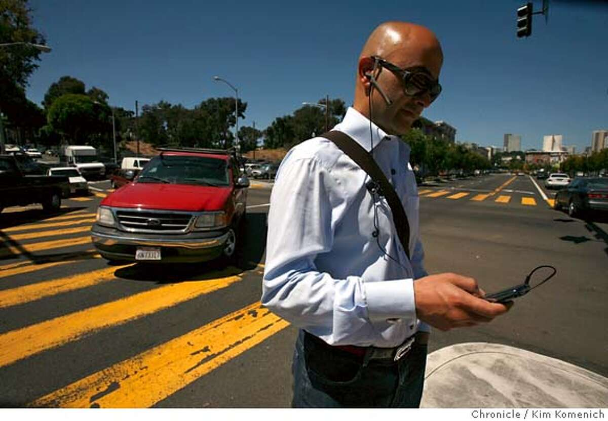 ACCIDENTS23_085_KK.JPG Ali Kia Shabahangi of San Francisco waits on the island in the middle of Octavia Stereet at Oak. The intersection of Oak and Octavia is the most dangerous place to be a pedestrian in the City and County of San Francisco, officials say. Photo by Kim Komenich/The Chronicle **Ali Kia Shabahangi MANDATORY CREDIT FOR PHOTOG AND SAN FRANCISCO CHRONICLE. NO SALES- MAGS OUT.