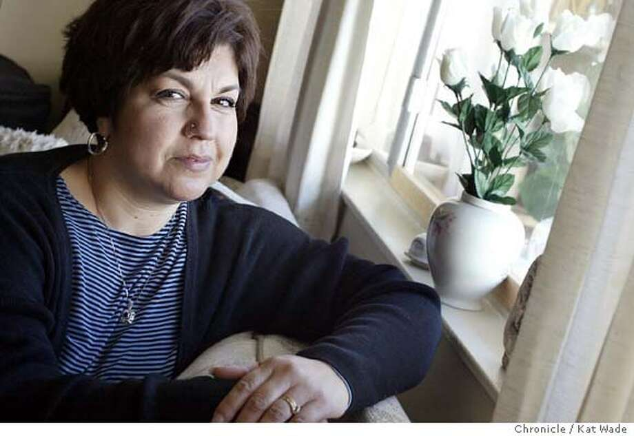 ORTIZ_0079_KW.jpg  Antoinette Ortiz who has had a string of bad luck including breast cancer, loosing her job, loosing her insurance and having her husband walk out, poses for a portrait in her Sunnyvale apartment. Through Season of Sharing the Chronicle is paying two months rent for Ortiz while she hunts for a job on 12/11/03 in Sunnyvale . Kat Wade / The Chronicle MANDATORY CREDIT FOR PHOTOG AND SF CHRONICLE/ -MAGS OUT Photo: Kat Wade