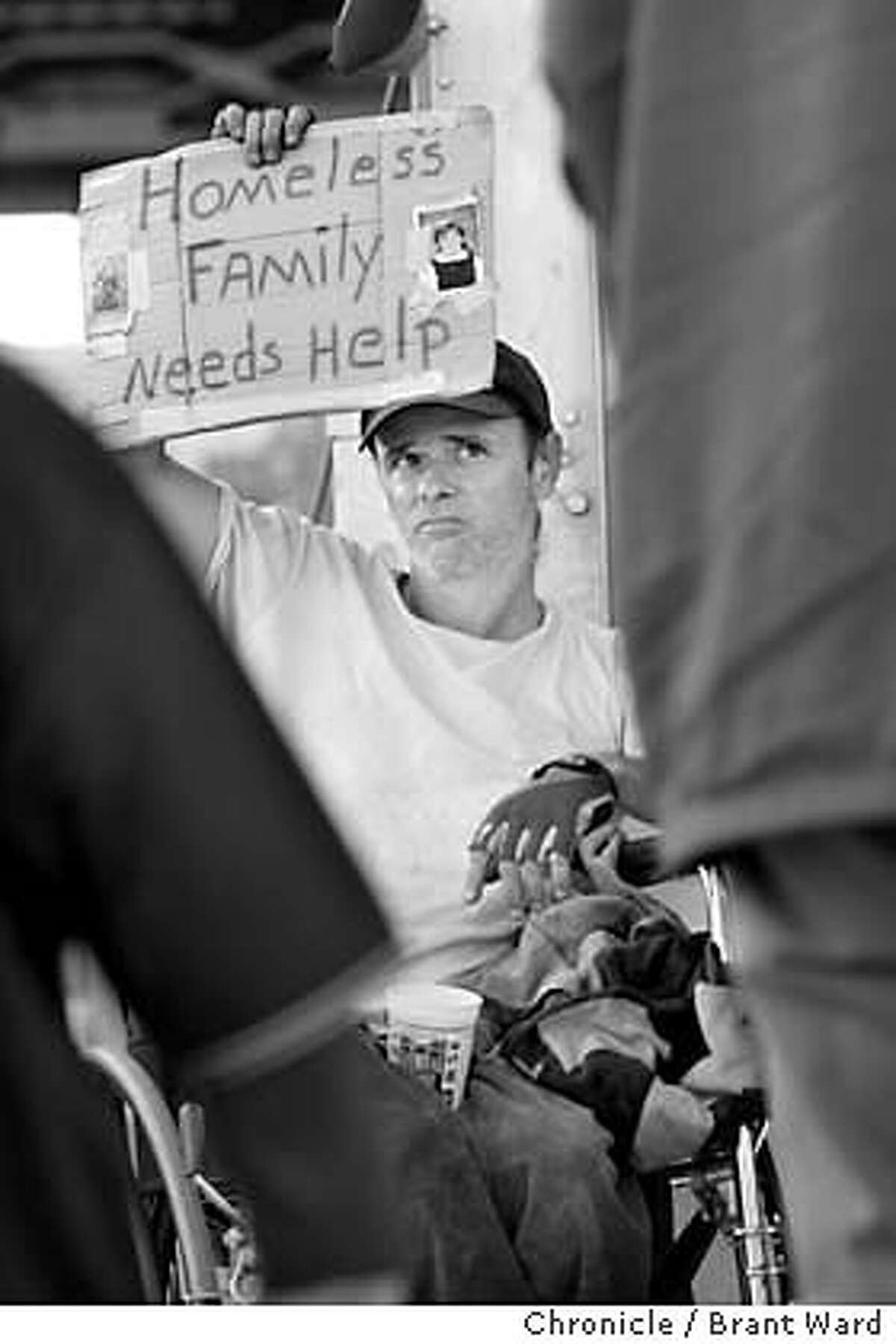 FAMILY. The Silver family, homeless, lives out of a van at the end of 24th Street in San Francisco. Tom often goes to San Francisco Giant games to panhandle...he puts his kids pictures on his sign. This night has not been kind to him. BRANT WARD / The Chronicle