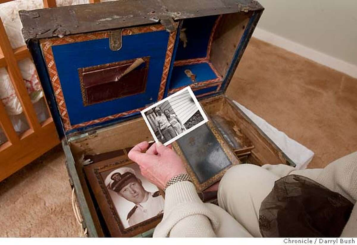 keepinghouse_trunk_0007_db.JPG Cynthia Overbeck Bix looks at a loose photo of her grandparents as she looks inside an old family trunk filled with her family memorabilia in Berkeley, CA, on Tuesday, June, 19, 2007. photo taken: 6/19/07 Darryl Bush / The Chronicle ** Cynthia Overbeck Bix (cq) MANDATORY CREDIT FOR PHOTOG AND SF CHRONICLE/NO SALES-MAGS OUT
