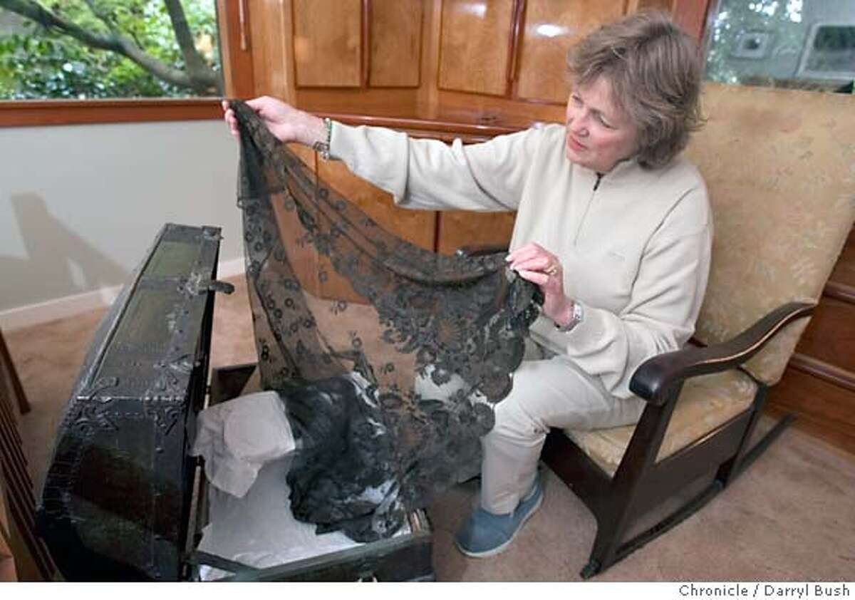 keepinghouse_trunk_0002_db.JPG Cynthia Overbeck Bix holds a black lace scarf that belonged to her