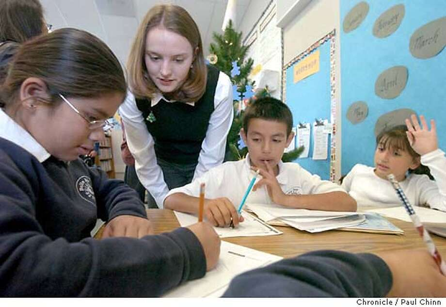 Fourth grade teacher Suzannah Nason helps Wendy Nicolas (left) with an assignment as fellow students Roberto Navarro (center) and Shereen Habash (right) follow along. Belle Air Elementary School in San Bruno on 12/17/03. PAUL CHINN / The Chronicle Photo: PAUL CHINN