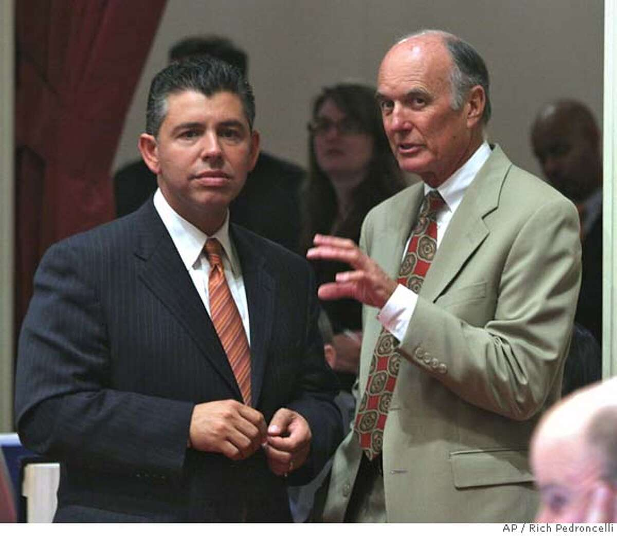 State Sen. Abel Maldonado, R-Santa Maria, left, and Senate Minority Leader Dick Ackerman, of Tustin, confer during the debate over the state budget at the Capitol in Sacramento, Calif., Tuesday, Aug. 21, 2007. Maldonado and Ackerman, were the only two Republicans to vote for the budget ending the stalemate that has lasted more than seven weeks beyond the July 1 start of the fiscal year. (AP Photo/Rich Pedroncelli)
