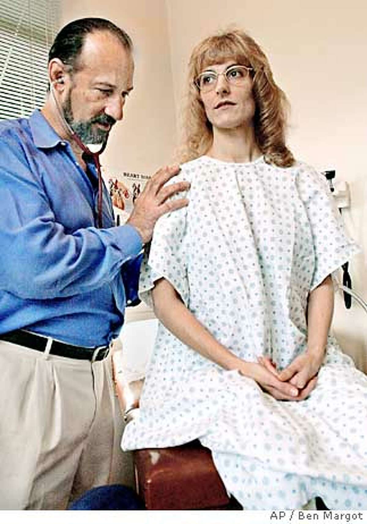 ** FILE ** Doctor Frank Lucido listens to the heartbeat of his patient Angel Raich, Jan. 13, 2003, in Berkeley, Calif. Raich sued the federal government to allow her to smoke marijuana without the fear of prosecution. An appeals court ruled Tuesday, Dec. 16, 2003, in Raich's favor, that a federal law outlawing marijuana does not apply to sick people who are allowed to smoke pot with a doctor's recommendation. (AP Photo/Ben Margot, File)
