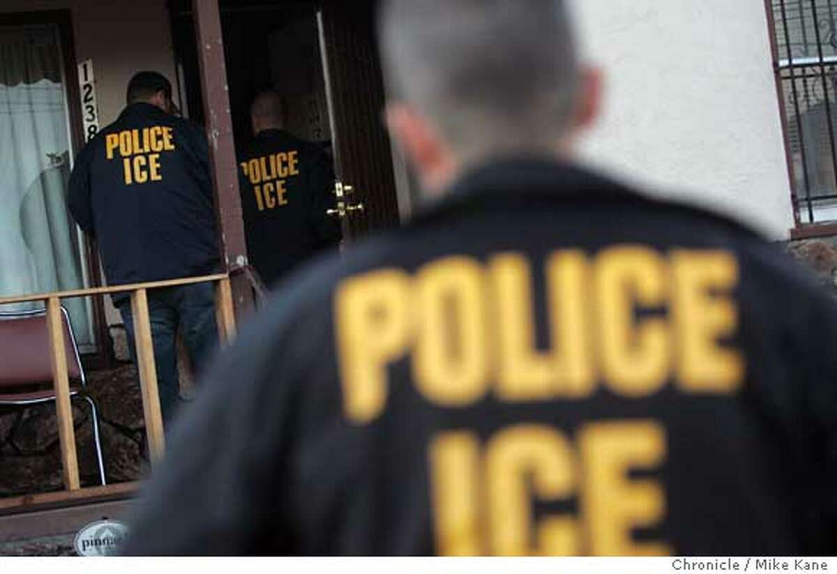 ICERAID22_061_MBK.JPG ICE agents enter a house in search of a criminal alien immigrant, for which they have an arrest warrant, in Oakland, CA, on Tuesday, August, 21, 2007. photo taken: 8/21/07 Mike Kane / The Chronicle * Ran on: 08-22-2007 Immigration and Customs Enforcement agents enter an Oakland house during a raid. Ran on: 08-22-2007 Immigration and Customs Enforcement agents enter an Oakland house during a raid. Ran on: 08-22-2007 Immigration and Customs Enforcement agents enter an Oakland house during a raid. Ran on: 08-22-2007 Immigration and Customs Enforcement agents enter an Oakland house during a raid. Ran on: 08-22-2007 Ran on: 08-22-2007 Ran on: 08-22-2007