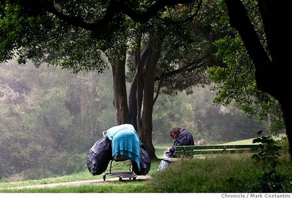 A man who gave his name as Roy, and who claims to live in the park sits on a bench under trees just west of the Hall of Flowers in Golden Gate Park. Photo: Mark Costantini / S.F. Chronicle