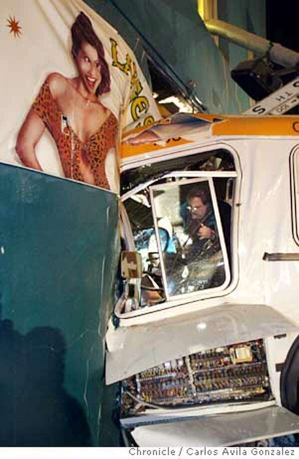 A muni bus drove into an adult bookstore on the corner of Mission and Sixth Street, causing some injuries but no deaths, Monday, Dec. 15, 2003.  Chronicle Photo - Carlos Gonzalez