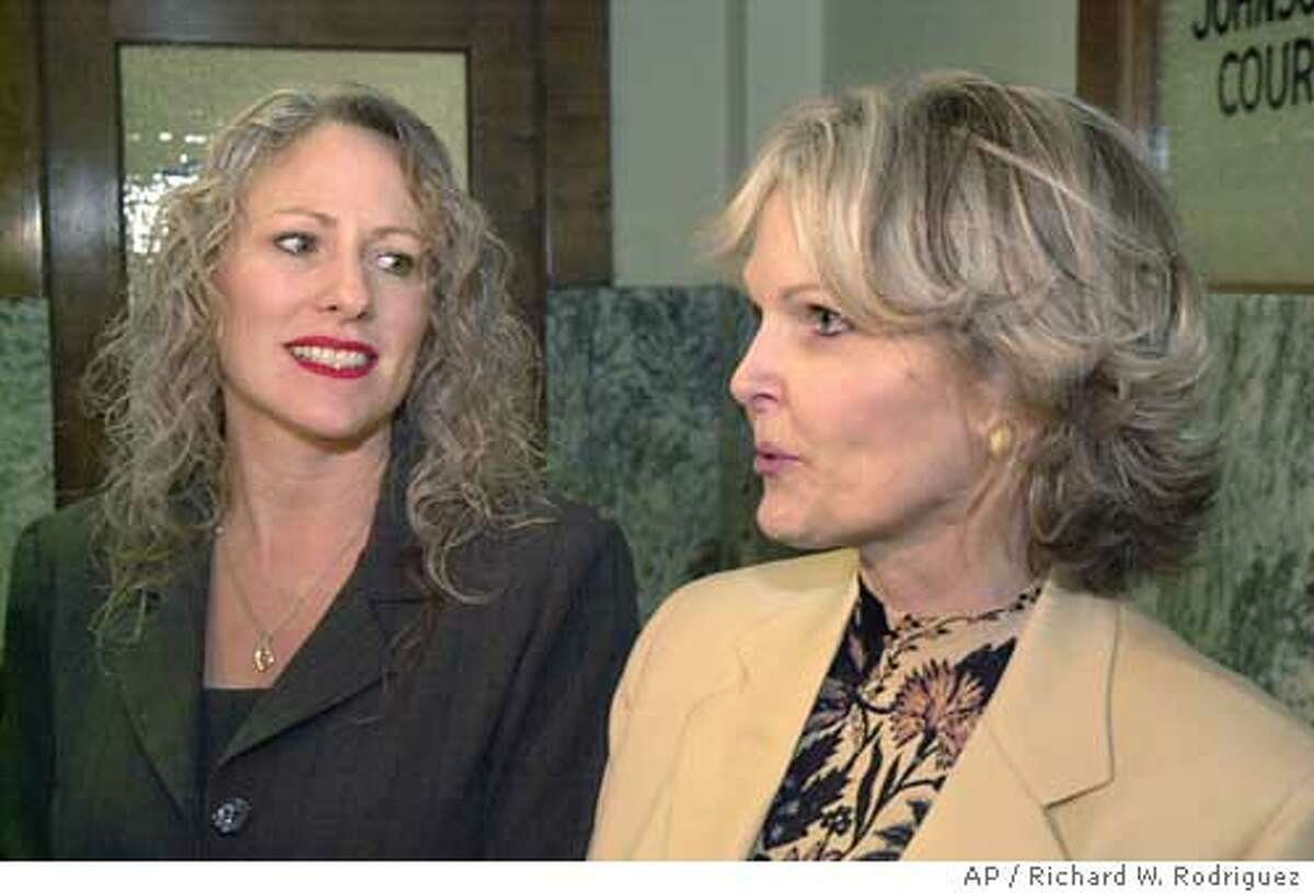 Joanne Webb, left, looks on as her atorney BeAnn Sisemore addresses the media Monday Dec. 15, 2003, at the Johnson County Courthouse in Cleburne, Texas, after a hearing. Webb intended to spice up marriages and earn extra cash by selling erotic toys as one of Passion Parties Inc.'s 3,000 national consultants. Instead, the former fifth-grade teacher and executive board member of the Burleson Chamber of Commerce faces criminal charges and embarrassment after a police sting. Webb made her first court appearance Monday. Judge Robert Mayfield approved a pretrial hearing but did not set a date. (AP Photo/Fort Worth Star-Telegram, Richard W. Rodriguez)