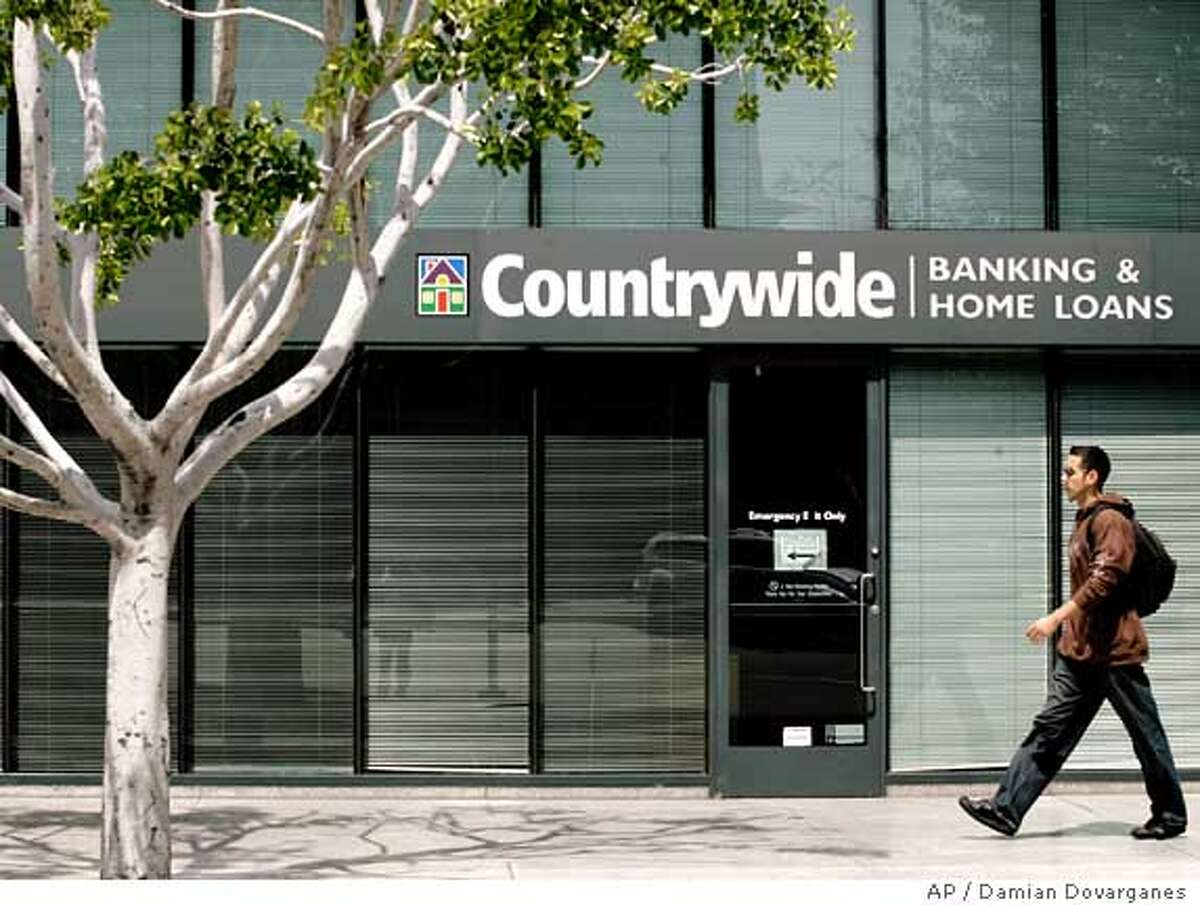 ** FILE ** The Countrywide Banking and Home Loans office in Glendale, Calif., is seen in this April 26, 2007 file photo . Countrywide Financial Corp., the nation's largest mortgage lender, has begun laying off staff as part of its effort to ride out the credit crunch that has rocked the home loan industry, according to a report published Monday, Aug. 20, 2007. (AP Photo/Damian Dovarganes, file)