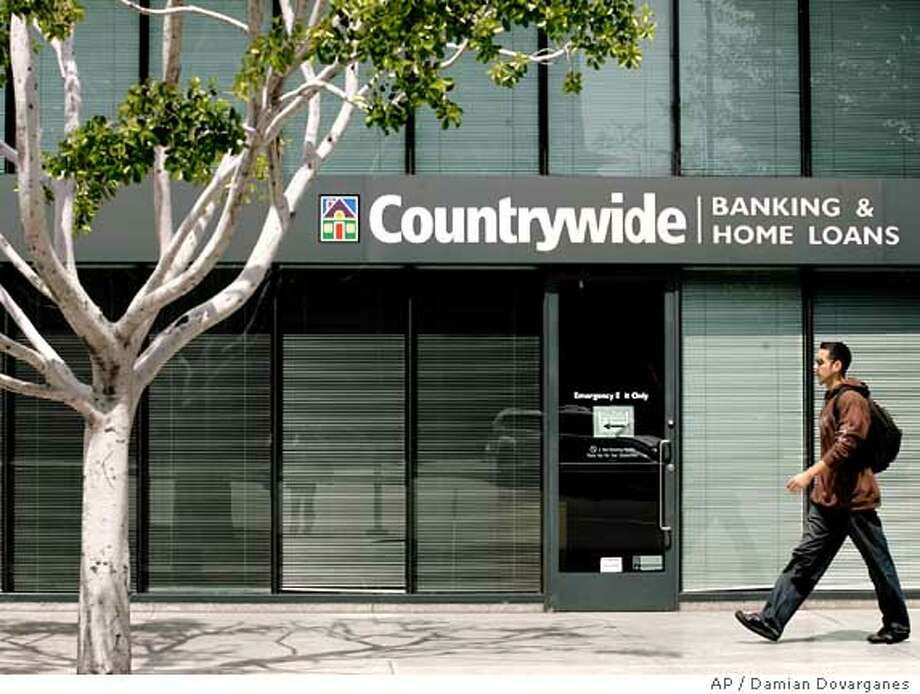 ** FILE ** The Countrywide Banking and Home Loans office in Glendale, Calif., is seen in this April 26, 2007 file photo . Countrywide Financial Corp., the nation's largest mortgage lender, has begun laying off staff as part of its effort to ride out the credit crunch that has rocked the home loan industry, according to a report published Monday, Aug. 20, 2007. (AP Photo/Damian Dovarganes, file) Photo: Damian Dovarganes