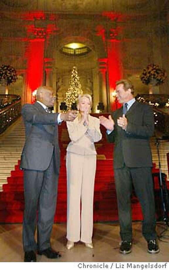 San Francisco Chief of Protocol Charlotte Shultz reacts after being escorted down the city hall stairs by San Francisco Mayor Willie Brown, and California Governor Arnold Schwarzenegger at her surprise party to honor her achievements. The city hall christmas tree is in the background. Liz Mangelsdorf/ The Chronicle MANDATORY CREDIT FOR PHOTOG AND SF CHRONICLE/ -MAGS OUT Charlotte Shultz, San Francisco chief of protocol, reacts in shock as she is escorted to a party in her honor at City Hall by Mayor Willie Brown and Gov. Arnold Schwarzenegger. Photo: LIZ MANGELSDORF