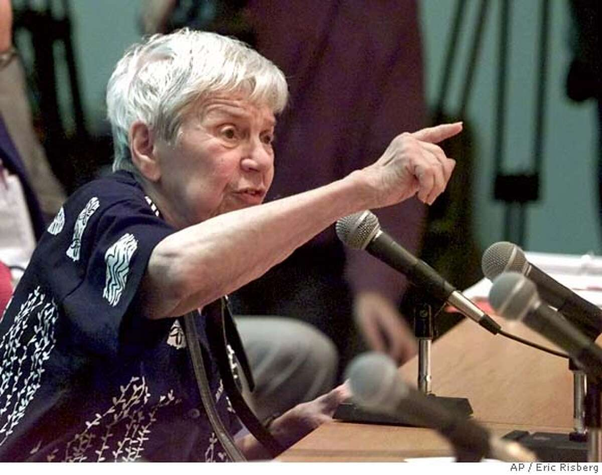 Consumer advocate Sylvia Siegel gestures while calling the state's deregulated power system a failure and fraud, during an emergency public hearing on rate hikes at the Public Utilities Commission in San Francisco, Tuesday, Jan. 2, 2001. Siegel said she spent $70 of her own money to leave her care facility to come and testify at the hearing. (AP Photo/Eric Risberg) CAT