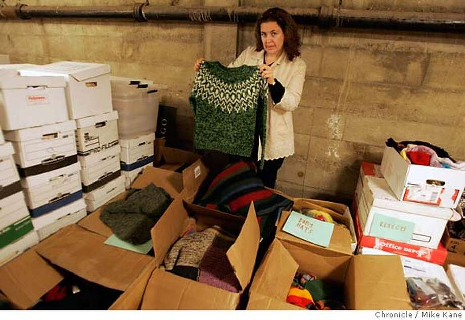 JA_RUBIN_068_MBK.JPG  Ann Rubin, founder of afghans(sic) for Afghans, an organization that donates warm blankets and clothing to the people of war torn Afghanistan, stands with boxes of donated knitted wool apparel at the organization's storage basement in San Francisco, CA, on Wednesday, August, 15, 2007. photo taken: 8/15/07  Mike Kane / The Chronicle *Ann Rubin Ran on: 08-19-2007  Ann Rubin founded afghans for Afghans, which distributes sweaters and blankets in Afghanistan. Photo: MIKE KANE