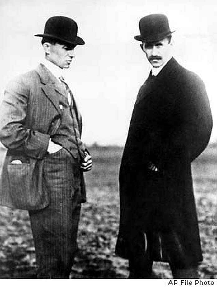 Wilbur Wright, left, and Orville Wright are shown in this undated photo. The Wright brothers worked together to build and fly the first Wright Biplane, which made a successful flight on December 17, 1903 at Kill Devil Hills near Kitty Hawk, North Carolina. (AP Photo) Wilbur Wright (left) and Orville Wright in an undated photo