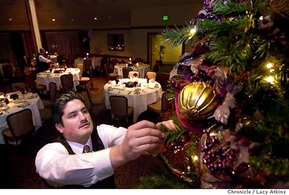 Jose L. Coppel fixes a bulb on the Christmas tree at the Stanford Park Hotel in preparation of a Holiday Party, Thursday Dec.11,2003, in Menlo Park. Photo by LACY ATKINS / The San Francisco Chronicle Photo: LACY ATKINS