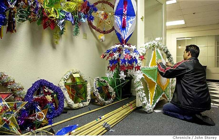 parol_119_jrs.JPG Story on Parols, a Christmas lantern used in the Philippines to decorate homes and businesses. Pictures of Parol making at the Bayaniman Community Center.  12/3/03 in San Francisco, CA.  JOHN STOREY / The Chronicle MANDATORY CREDIT FOR PHOTOG AND SF CHRONICLE/ -MAGS OUT Photo: JOHN STOREY
