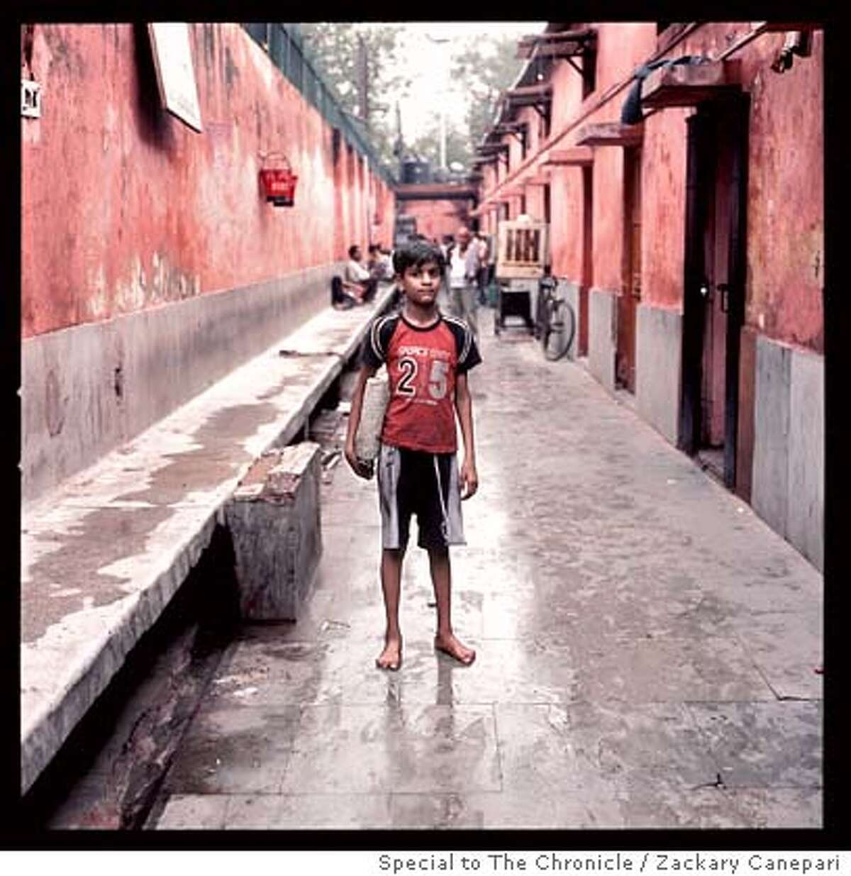 Kanaiya Kumar stands outside the Old Delhi boy's shelter. Zackary Canepari / Special to The Chronicle MANDATORY CREDIT FOR PHOTOG AND SAN FRANCISCO CHRONICLE/NO SALES-MAGS OUT