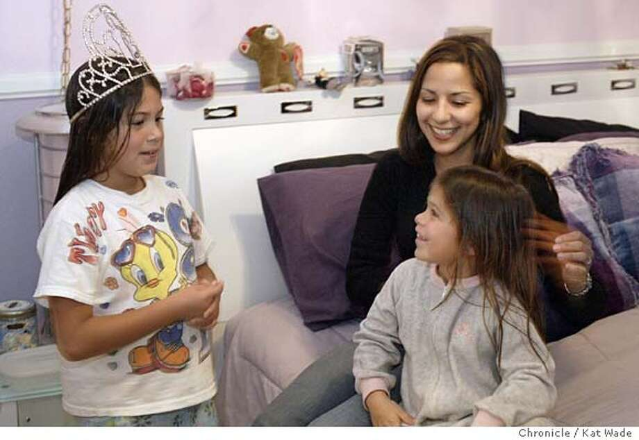 EBLATINA_0062_KW.jpg  On 12/3/03 while Angie Michel tries on her cousin's crown, Ruby Lopez, 23, (CENTER) 2003 Miss Latina USA, spends time taking care of her little cousins (L to R) Angie, 8, and Alex, 7, Michel that live with her and her parents Lucy and Ismael Lopez in their Livermore home. Kat Wade / The Chronicle Photo: Kat Wade