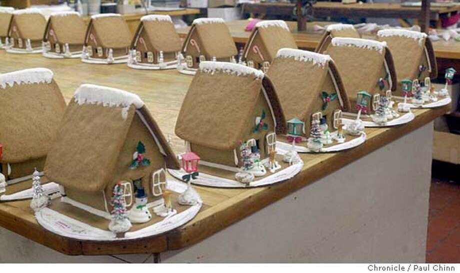 ebdish12045_pc.jpg There are enough gingerbread houses to start a neighborhood at Neldams. Holiday-themed pastries at Neldams Danish Bakery in Oakland on 12/6/03. PAUL CHINN / The Chronicle Photo: PAUL CHINN