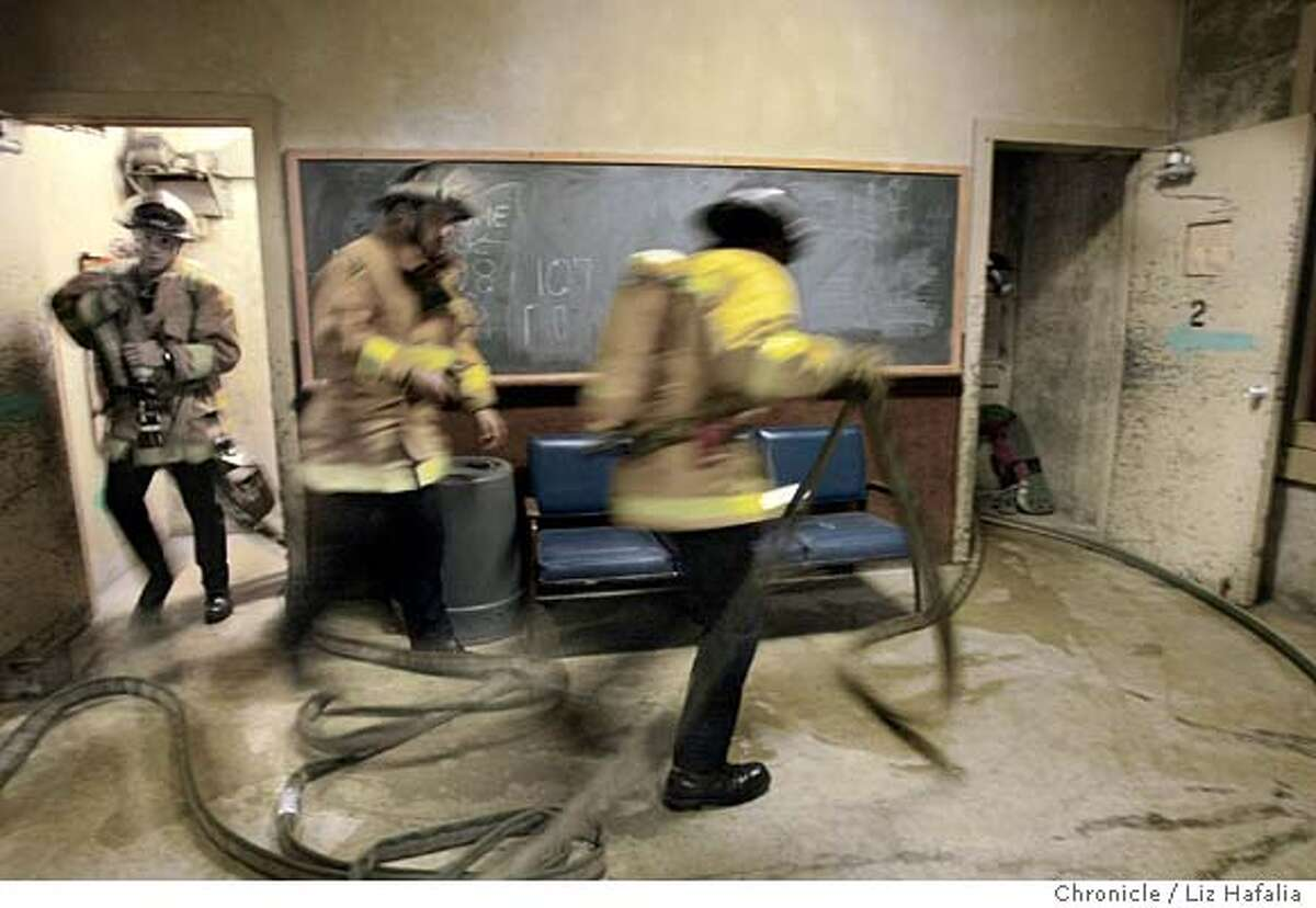 San Francisco Fire Department's Reserve Academy trains reserve firefighters who accompany S.F. Fire Dept. members on emergency runs and fires. Shot on 11/20/03 in San Francisco. LIZ HAFALIA / The Chronicle