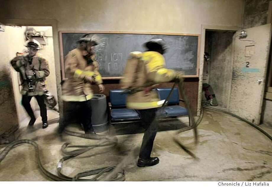 San Francisco Fire Department's Reserve Academy trains reserve firefighters who accompany S.F. Fire Dept. members on emergency runs and fires. Shot on 11/20/03 in San Francisco. LIZ HAFALIA / The Chronicle Photo: LIZ HAFALIA